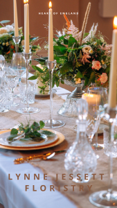 Crystal cut-glass and tall glass candlesticks with gold and green flowers
