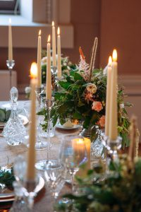 Bride and Grooms Table decorated with flowers and candlelight