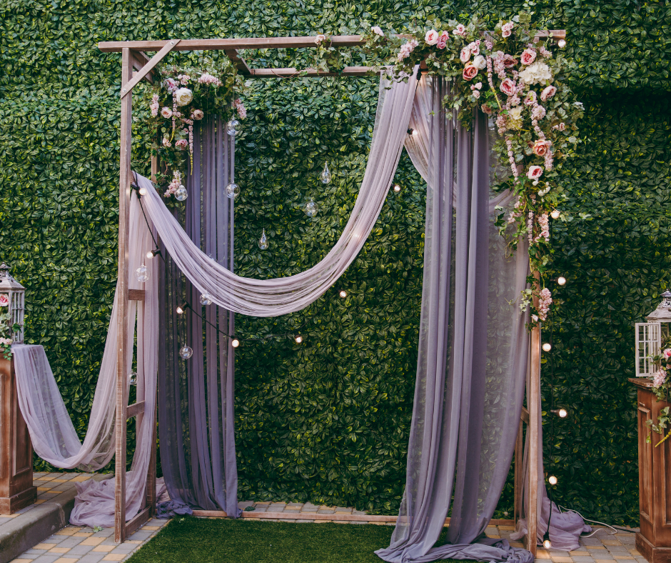 Wedding Ceremony Area draped with lilac material and flowers in a boho style