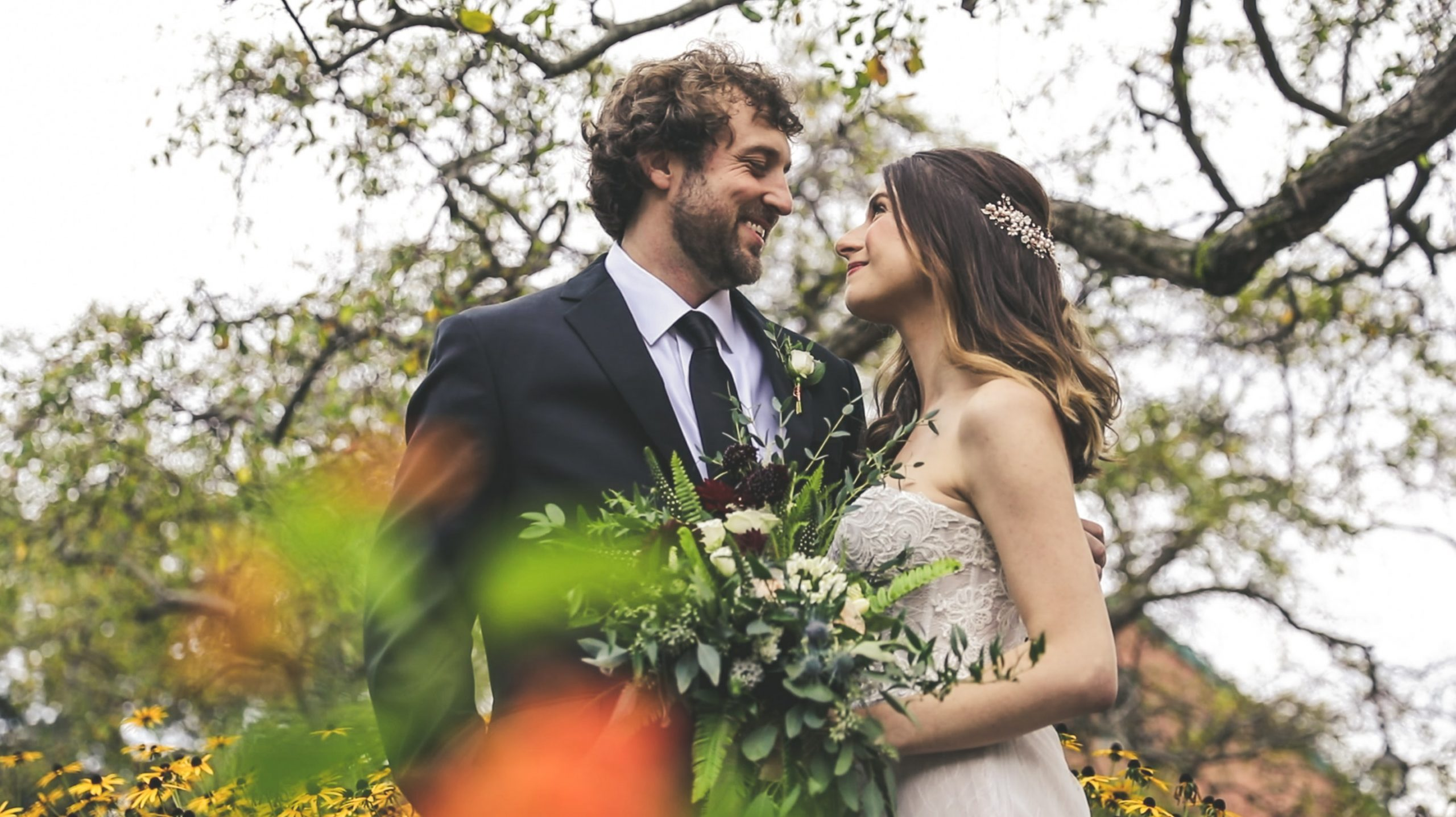 bride and groom in a garden setting