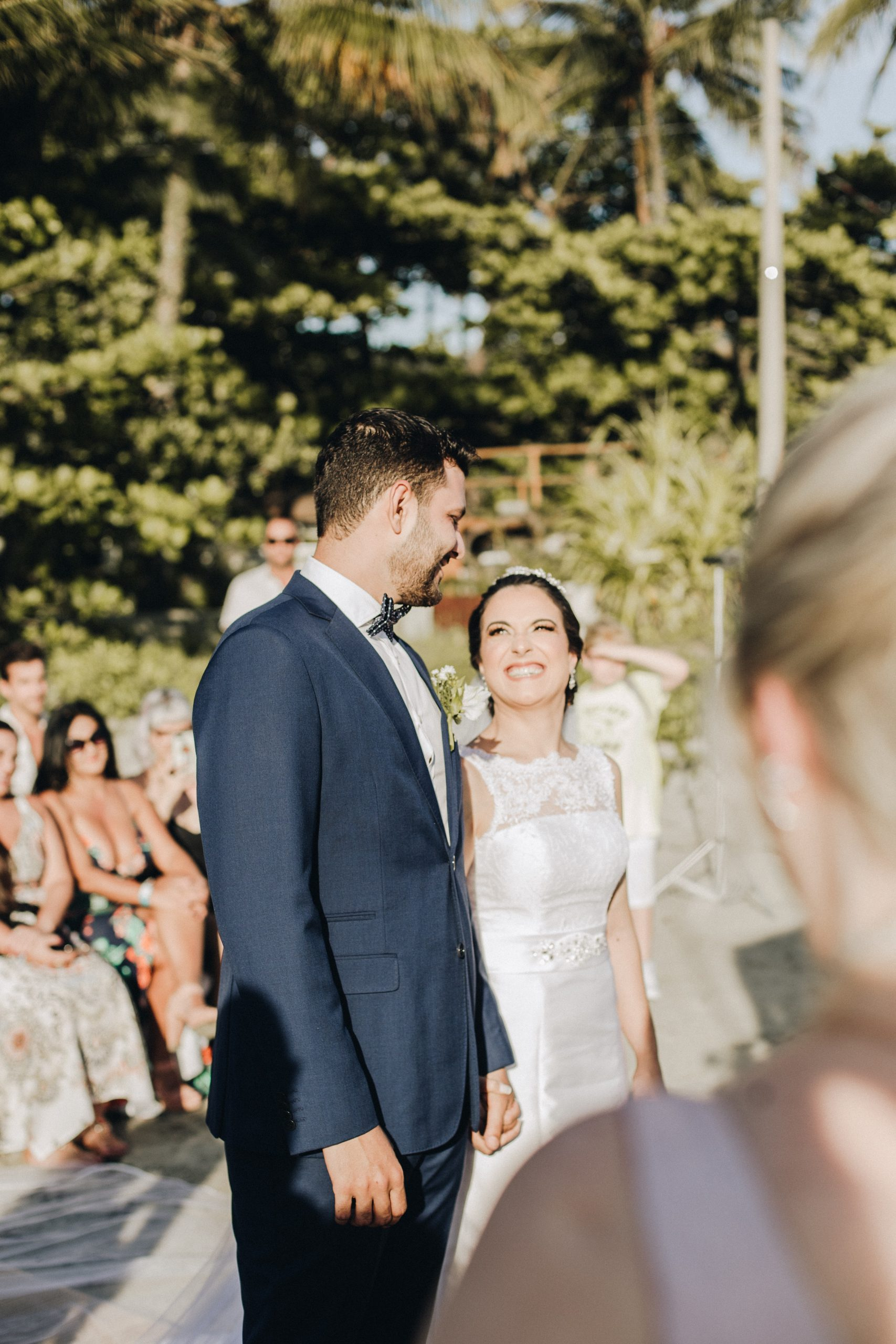 bride and groom looking into each others eyes as they exchange wedding vows in an outdoor setting