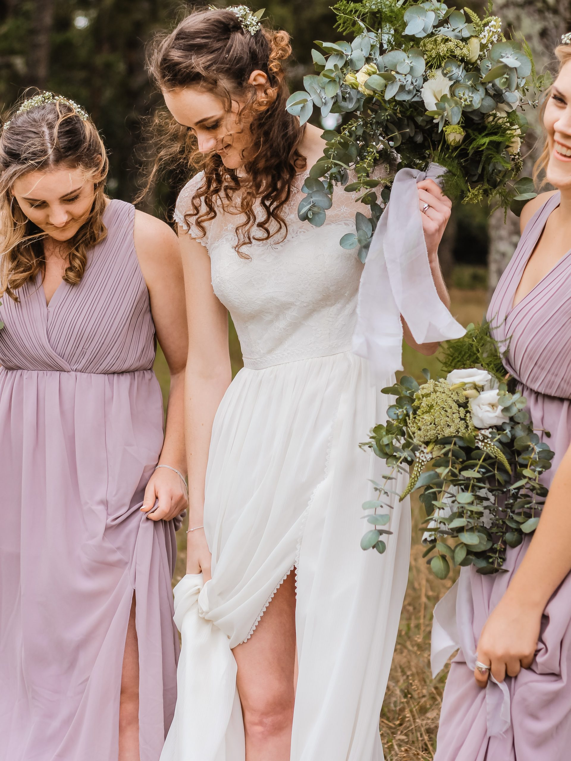 bride and bridesmaids dressed in lilac grecian style dresses