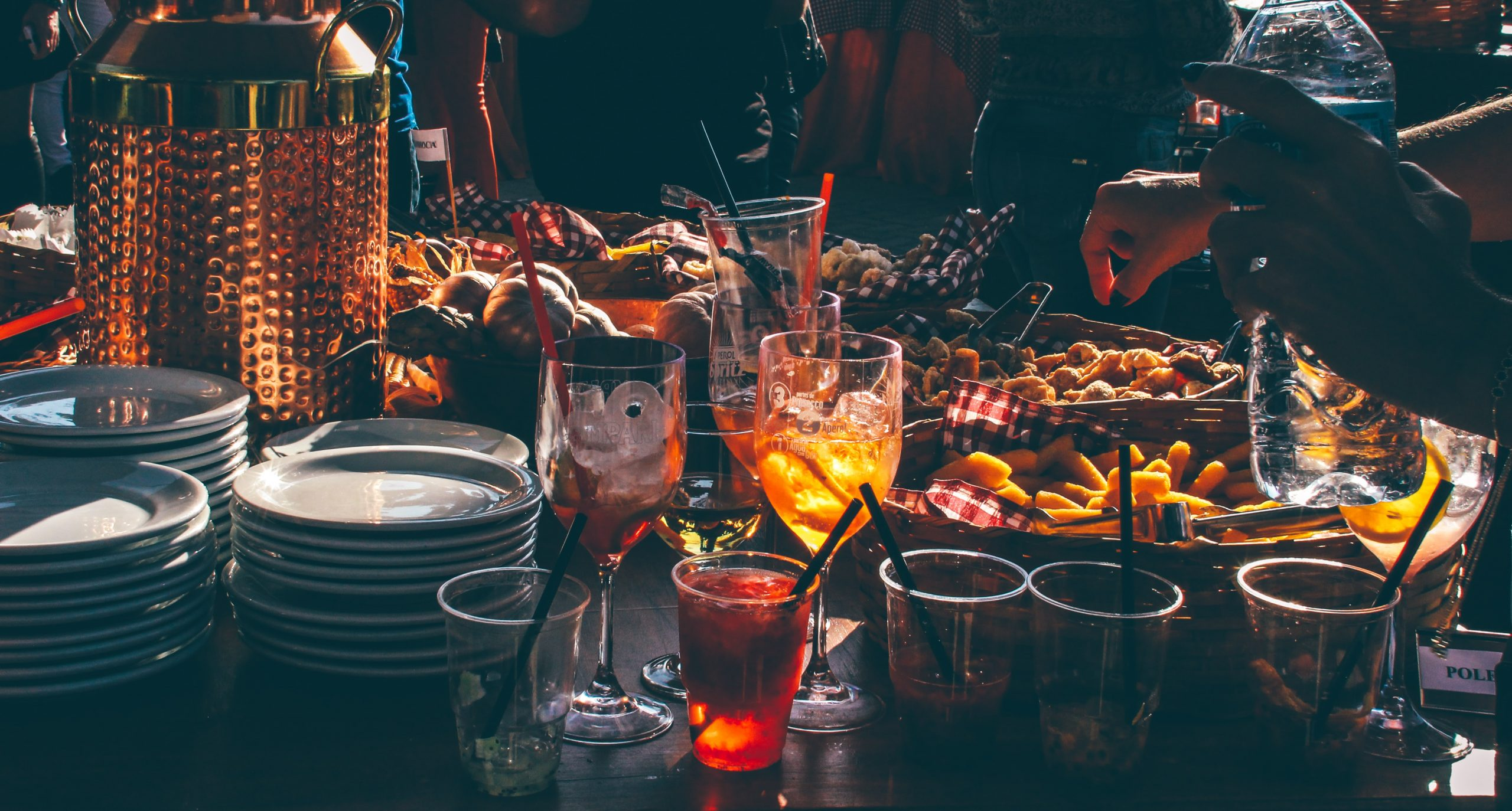 food and drinks on a table at an evening party
